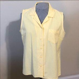 Sleeveless button up shirt.